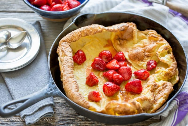 Dutch Baby or German Pancake with Grand Marnier soaked Strawberries and Vanilla Bean Ice Cream
