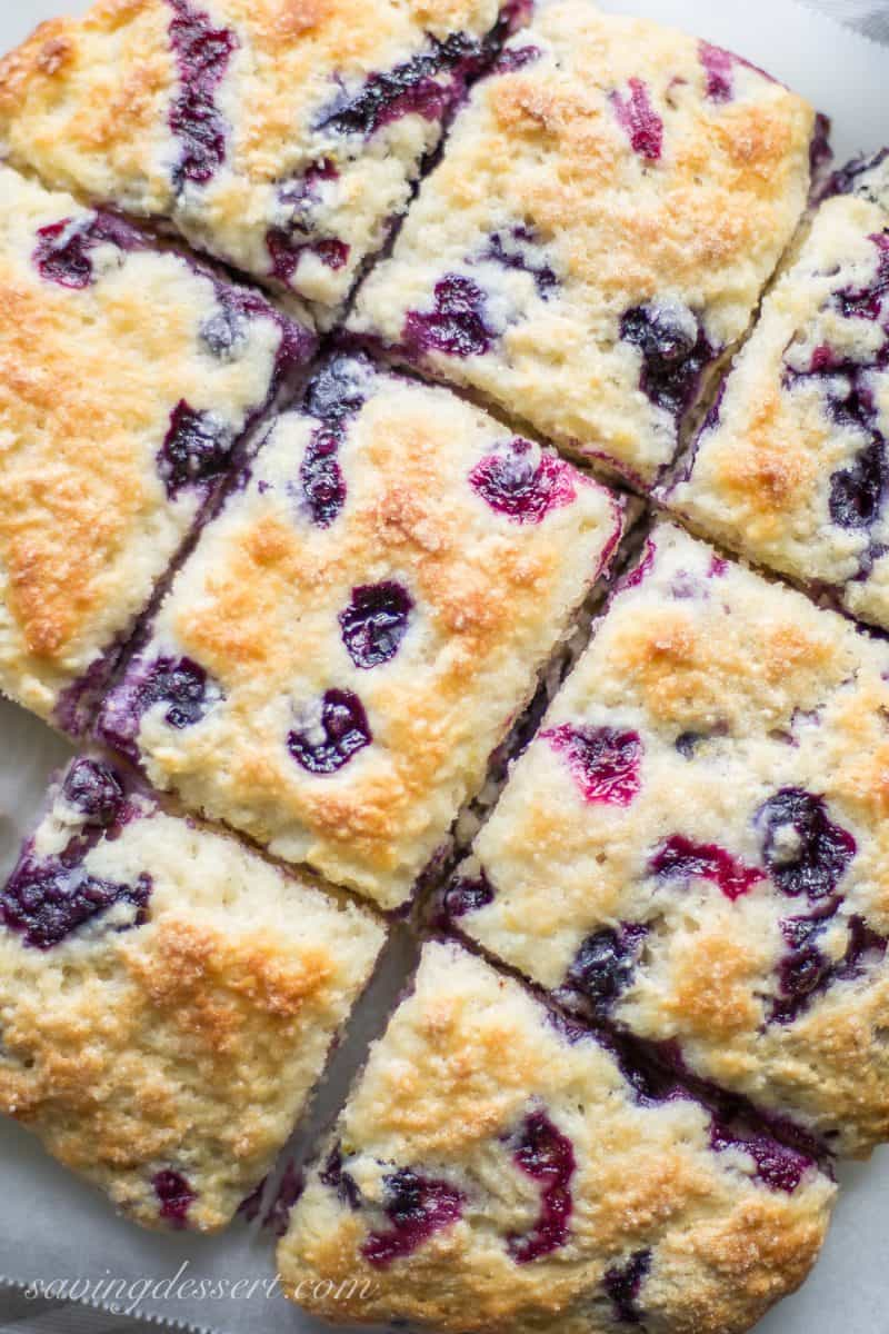 A close up of square sliced blueberry biscuits