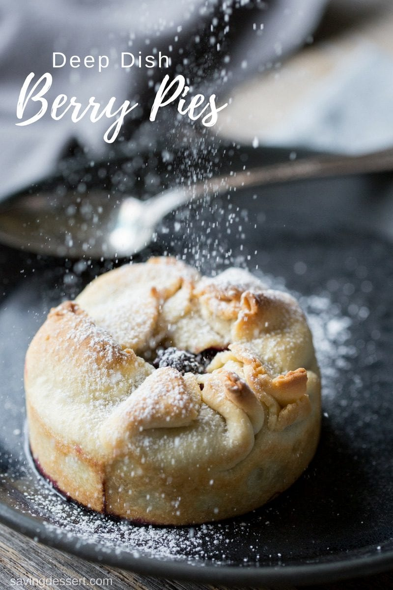 A mini pie being sprinkled with powdered sugar