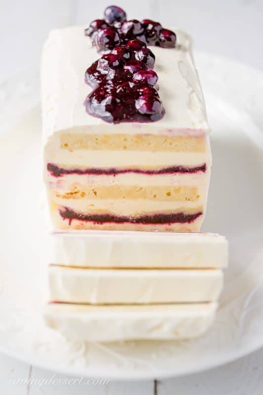 A frozen icebox cake with blueberry sauce on top