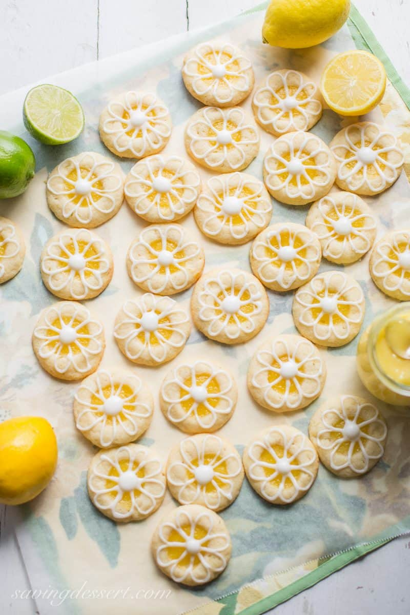 Lemon-Lime Shortbread Thumbprint Cookies with a flower design made of icing