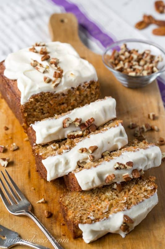 Carrot Loaf Cake - a deliciously moist cake loaded with fresh grated carrots and crushed pineapple, all topped off with a silky smooth cream cheese icing   www.savingdessert.com