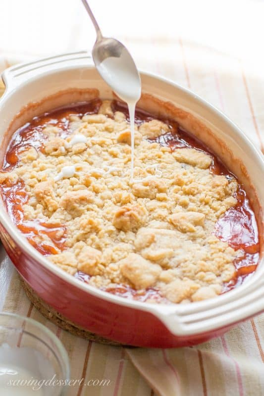 """Easy Peach Crumble - a delicious fresh fruit crumble made with a flour, butter and sugar mixture that is """"crumbled"""" on top of sweetened fruit.   www.savingdessert.com"""