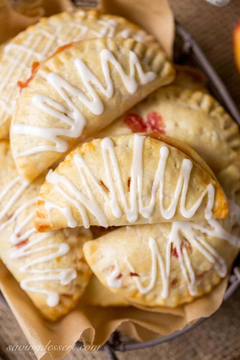 Peach hand pies with a drizzle of icing