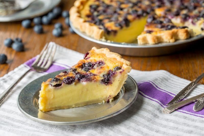 A slice of blueberry buttermilk pie