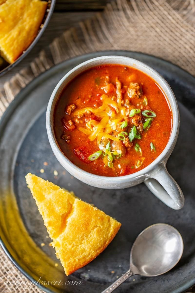 A cup of Chasen's Famous Chili with cornbread