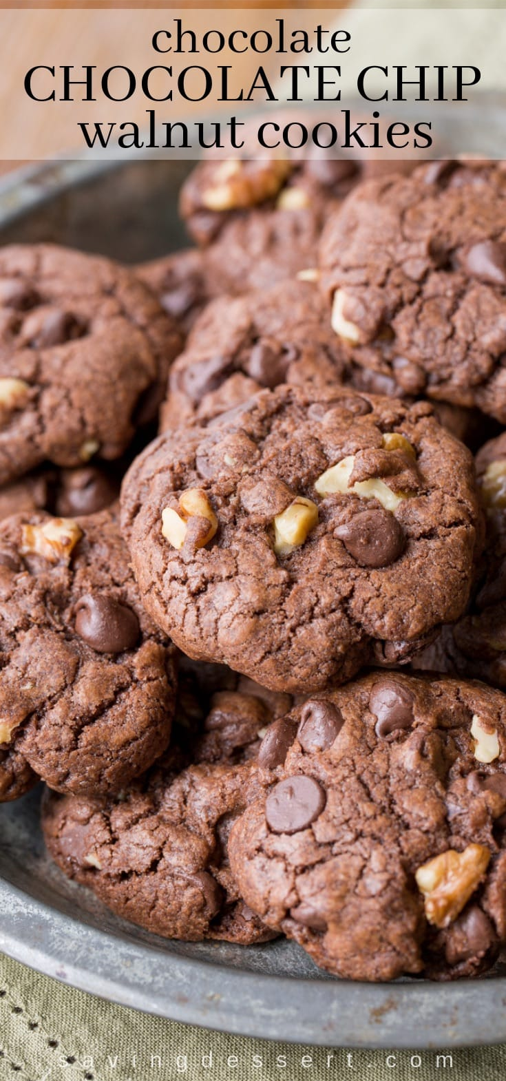 Thick and chewy Chocolate Chocolate-Chip Walnut Cookies have crispy edges, a soft almost brownie-like middle, and are loaded with big chunks of walnuts. #chocolatecookies #walnutcookies #cookies #chocolatechipcookie #chocolatechocolatechipcookie #chocolatewalnutcookie #easycookie