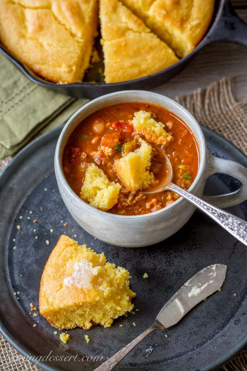 Easy Skillet Buttermilk Cornbread - perfect served with add-ins like cheese and hot peppers, cornbread is an inexpensive side dish great served with a simple bowl of pinto beans, chili, stew or soup. www.savingdessert.com