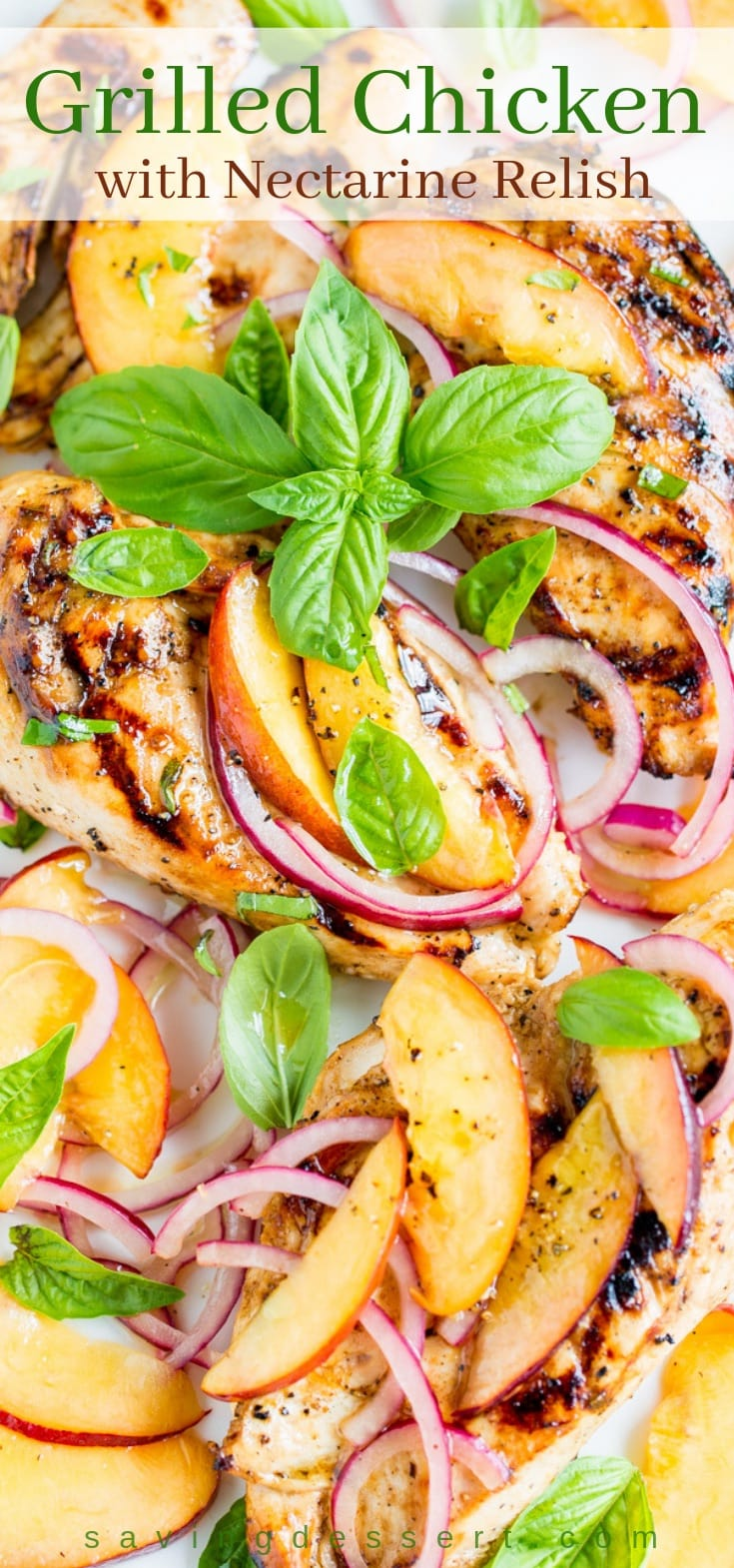 A close up of grilled chicken breasts topped with a nectarine relish with basil and red onion