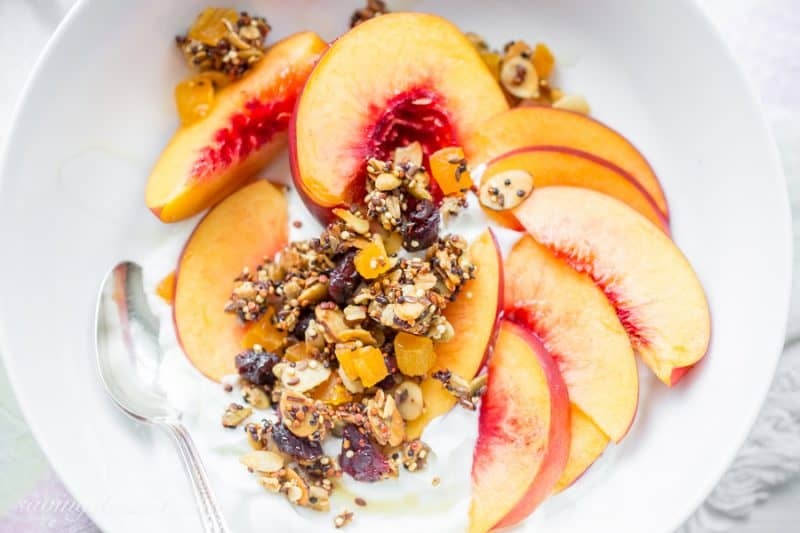 Quinoa Granola with oats, almonds, pepitas and dried fruit | www.savingdessert.com