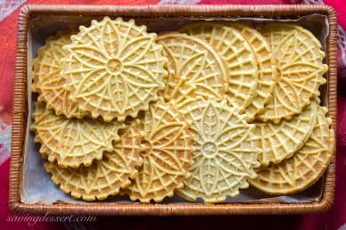 A basket filled with pumpkin pizzelles