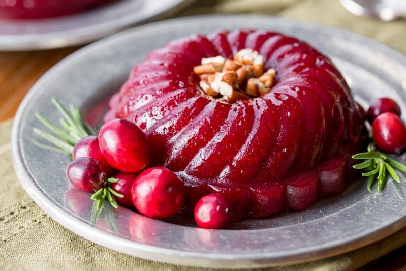 Boozy Cranberry Sauce - Ruby Port wine and Grand Marnier make a terrific pair when matched with tart cranberries, fresh rosemary and sliced ginger in this deliciously easy, grown-up, Boozy Cranberry Sauce. www.savingdessert.com