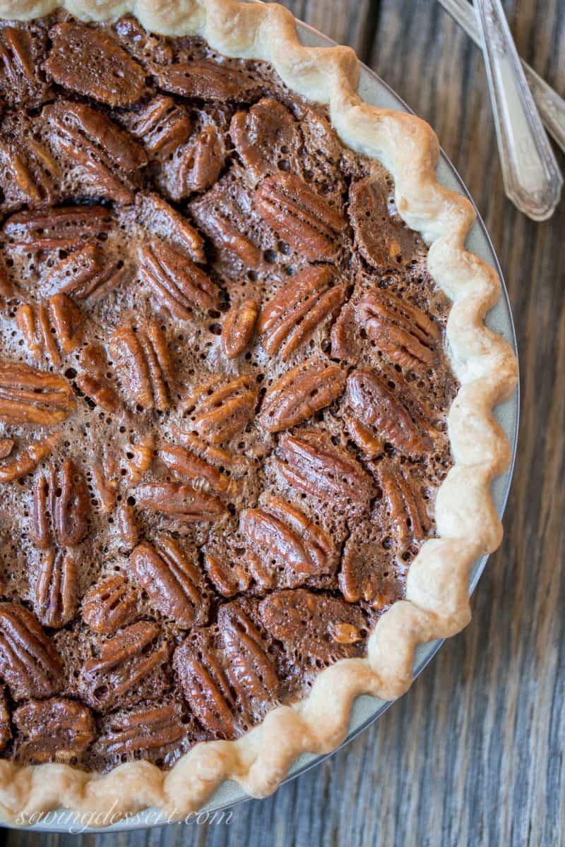 Chocolate Pecan Pie - our family favorite -Fudgy and rich, this is an easy pie to make and a favorite of everyone during the holidays. www.savingdessert.com