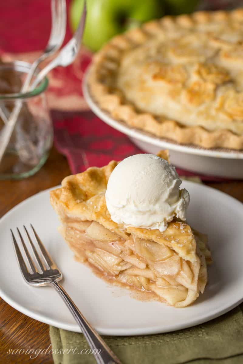 Classic Apple Pie - sliced with a scoop of vanilla ice cream on top