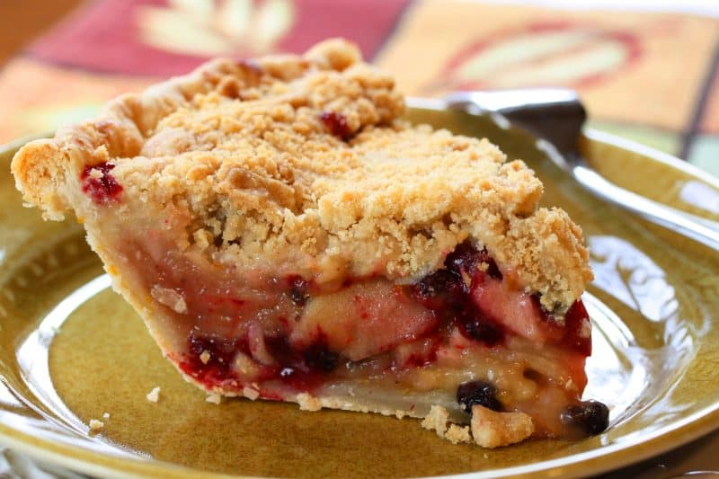Apple, Cranberry & Current Crumb Pie ~ brandy soaked currents, crisp juicy apples, tart cranberries and a sweet crumb topping wrapped up in a flaky crust ! www.savingdessert.com