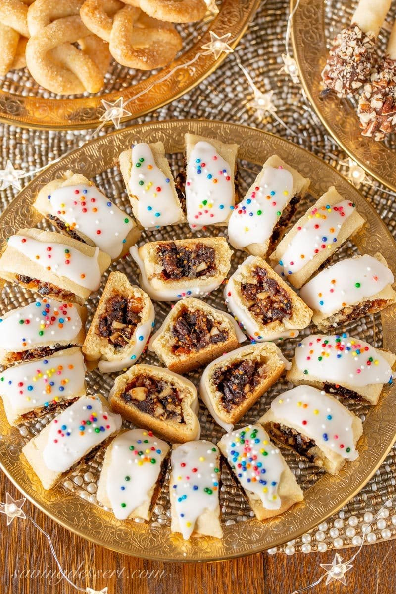 A holiday plate of Italian Fig Cookies with colorful sprinkles