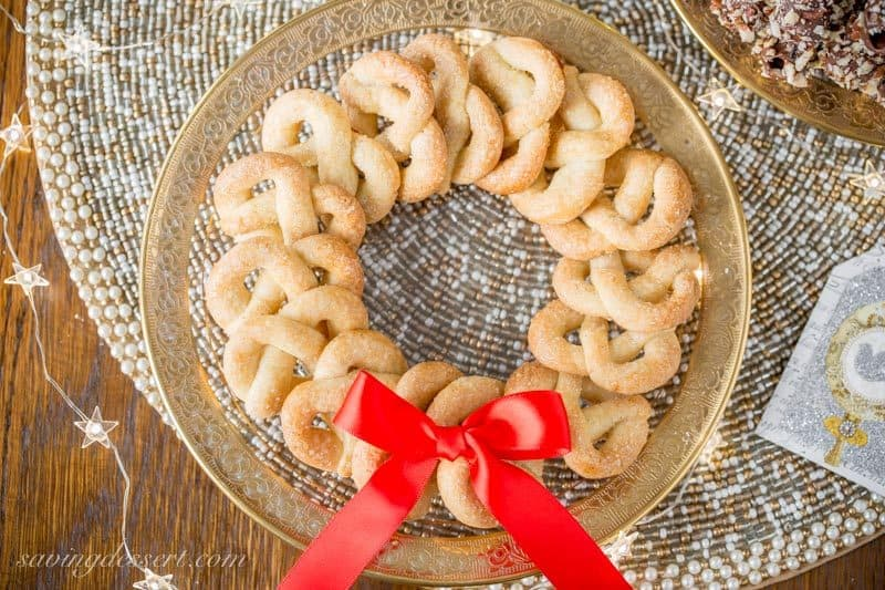 Vanilla Pretzel Cookies ~ a crisp little butter cookie loaded with vanilla beans and topped with sparkly coarse sugar in a fun festive shape! www.savingdessert.com