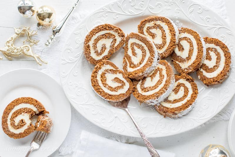 This Gingerbread Roll with Lemon Cream Cheese Filling – a delightful dessert that's not too sweet, is loaded with warm, aromatic spices and flavored with just the right amount of molasses. www.savingdessert.com