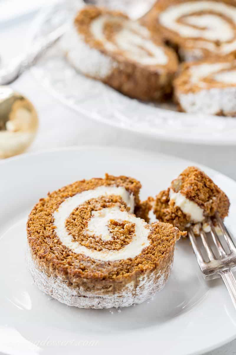 Gingerbread Roll - with Lemon Cream Cheese Filling – a delightful dessert that's not too sweet, is loaded with warm, aromatic spices and flavored with just the right amount of molasses. We are thrilled with this recipe! www.savingdessert.com