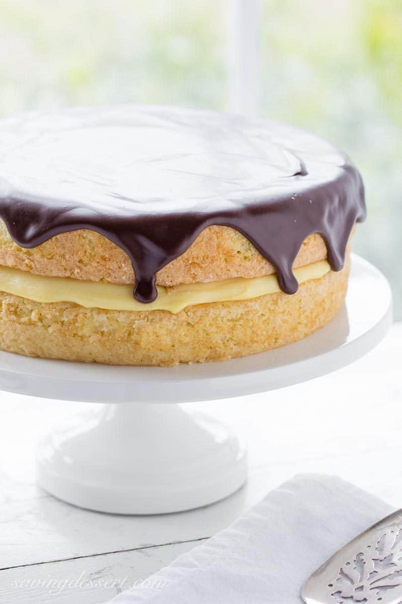 Classic Boston Cream Pie ~ moist, tender sponge cake filled with a layer of rich, smooth vanilla pastry cream, then topped with a delicious bittersweet chocolate glaze. | chocolate | Boston Cream Pie | Pastry Cream | chocolate ganache | www.savingdessert.com