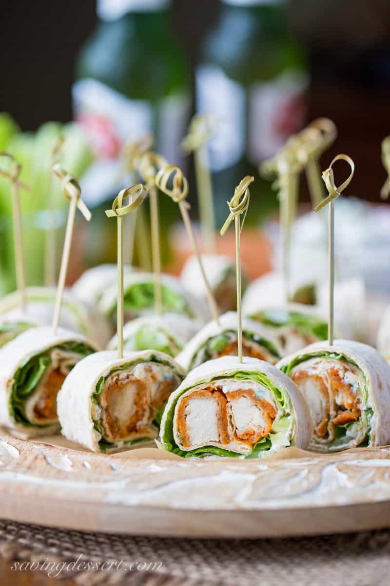 Buffalo Chicken wraps cut into small appetizers with blue cheese