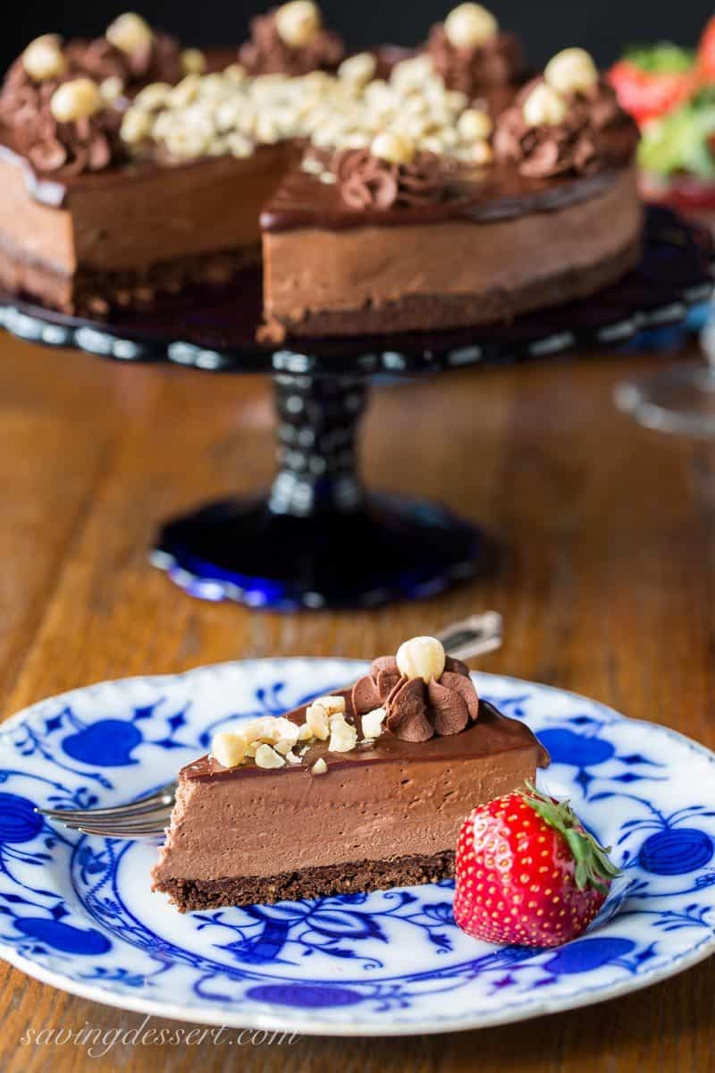 Chocolate Hazelnut Mousse Cake ~ a light and fluffy Nutella chocolate mousse spread over a chocolate hazelnut shortbread crust, topped with a simple chocolate ganache and garnished with chopped toasted hazelnuts. www.savingdessert.com