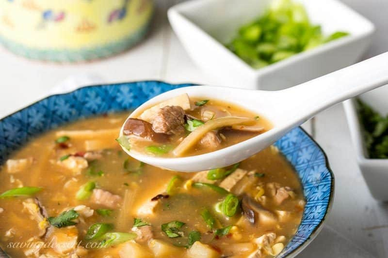 Fresh, easy and delicious, Hot & Sour Soup loaded with tofu, mushrooms and pork tenderloin in a rich and full flavored chicken broth. Way better than take-out! www.savingdessert.com