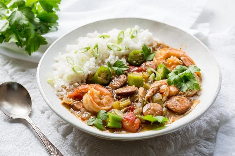 Chicken, Sausage & Shrimp Gumbo ~ with the Holy Trinity of Lousiana cooking (celery, onion and bell pepper), roast chicken, andouille sausage and shrimp are slowly simmered in chicken broth flavored by a rich, dark roux made the Cajun way!