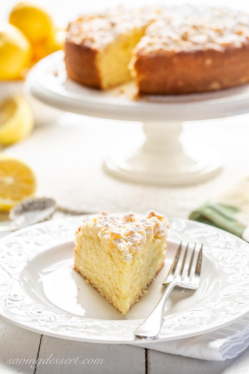 A slice of lemon cake on a plate with a fork