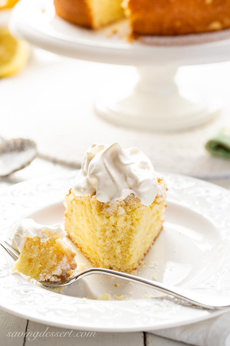 A slice of cake topped with whipping cream