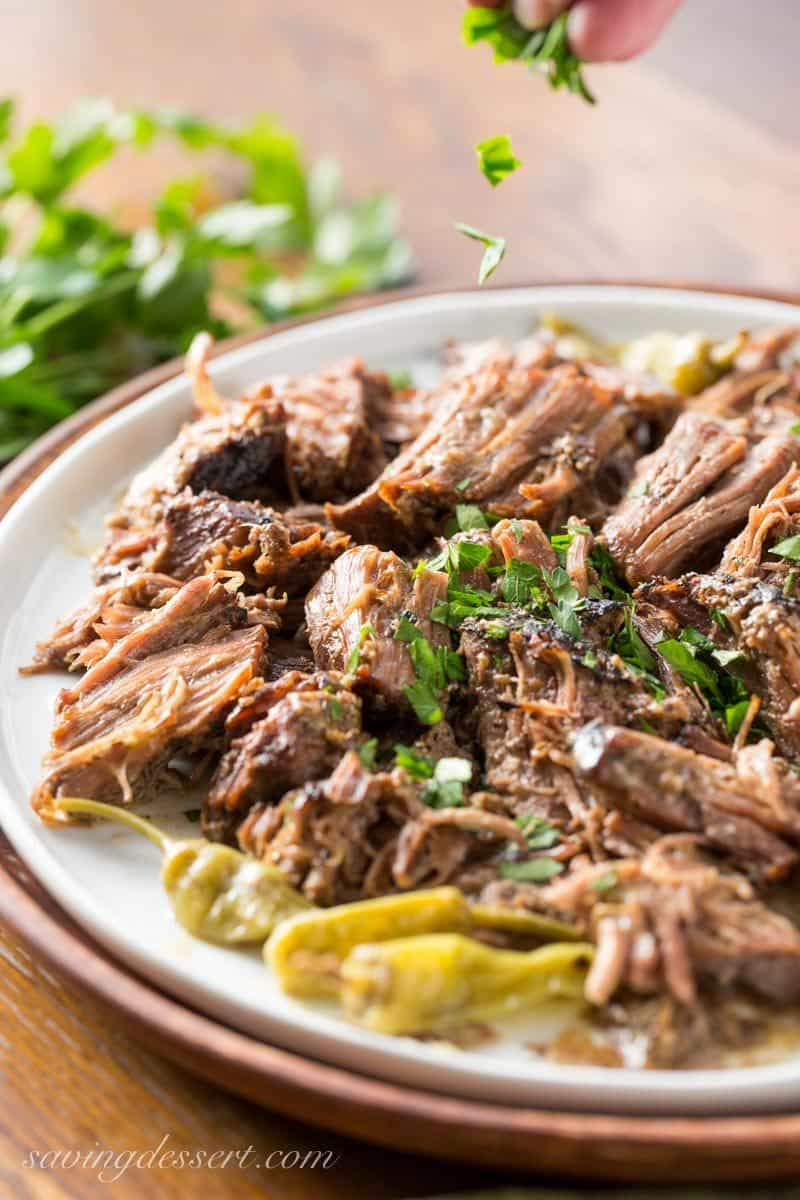 Mississippi Pot Roast - a tender, well flavored slow cooker pot roast with pepperoncini peppers and a simple homemade ranch dressing. The briny little peppers add a spicy punch of flavor, and it couldn't be easier to make! www.savingdessert.com