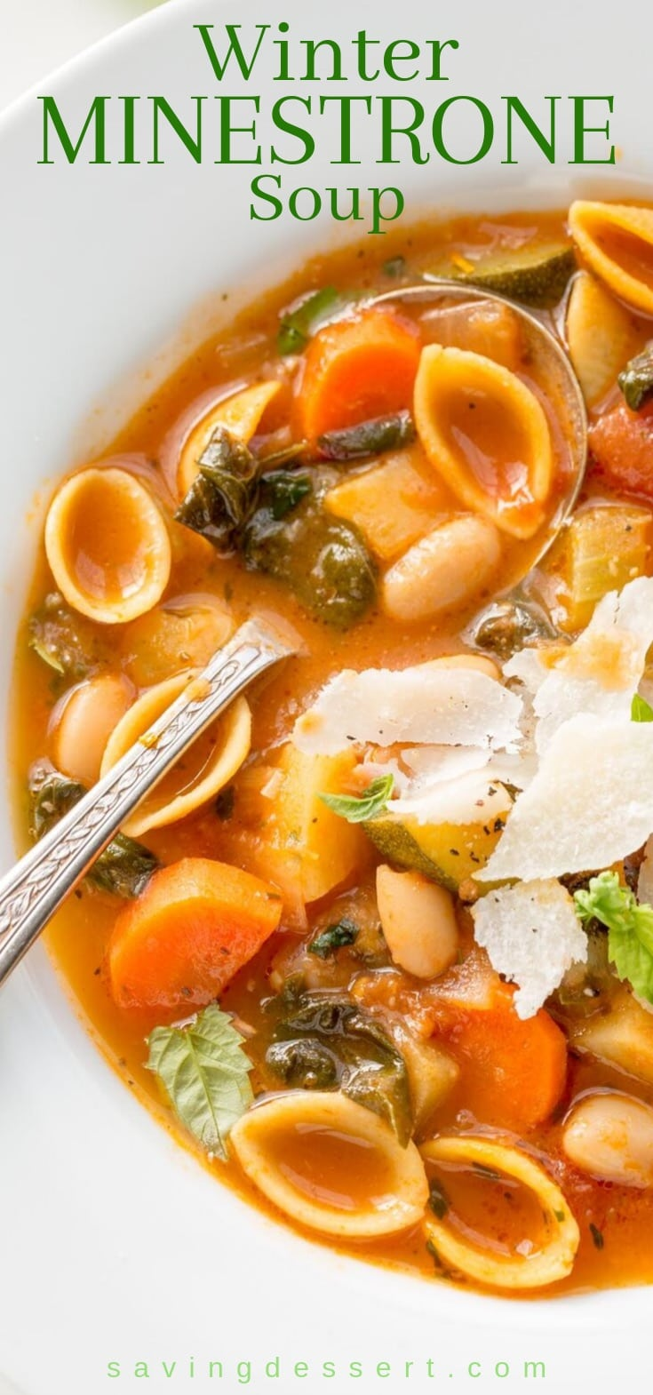 A bowl of winter minestrone soup with pasta and greens