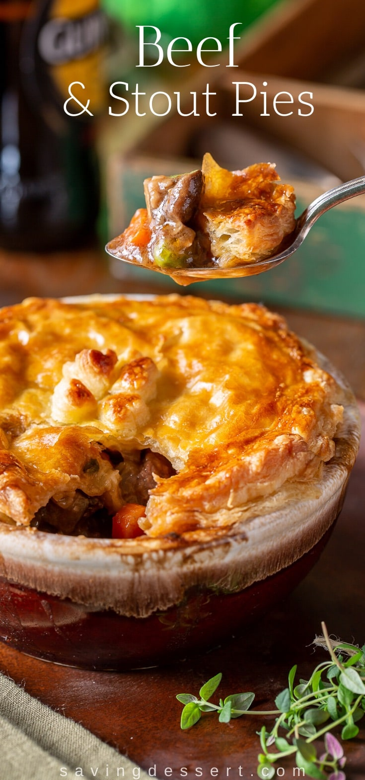 A bowl of Irish beef and stout pies baked in a bowl with golden brown puff pastry on top