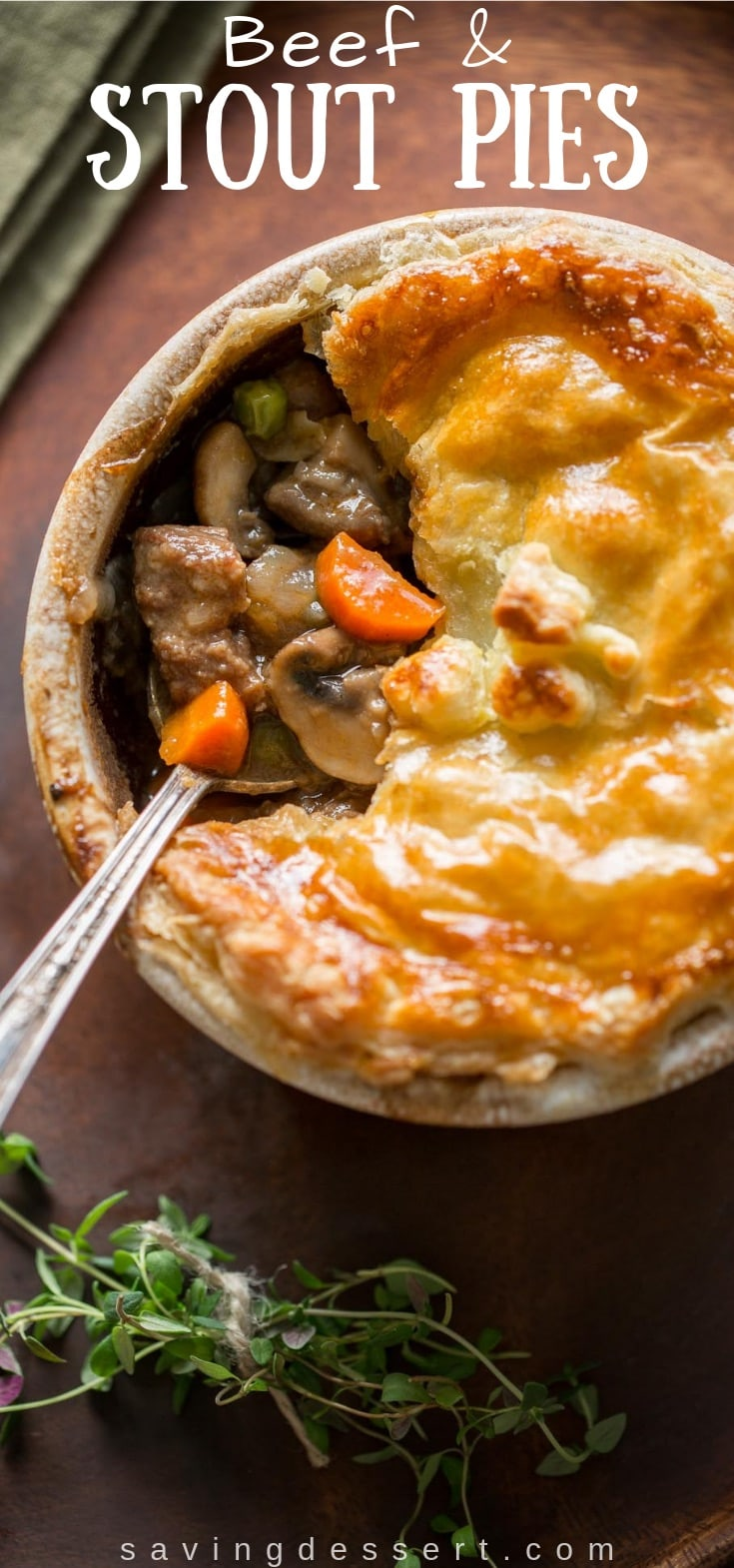 Beef and Stout Pies ~ tender chunks of beef are slow simmered in a rich stout broth with fresh thyme, cremini mushrooms, carrots, peas and onions. #stoutpies #irishpie #beefpie #Irishbeefpie #savorypie #flakypie #dinner #irishrecipe