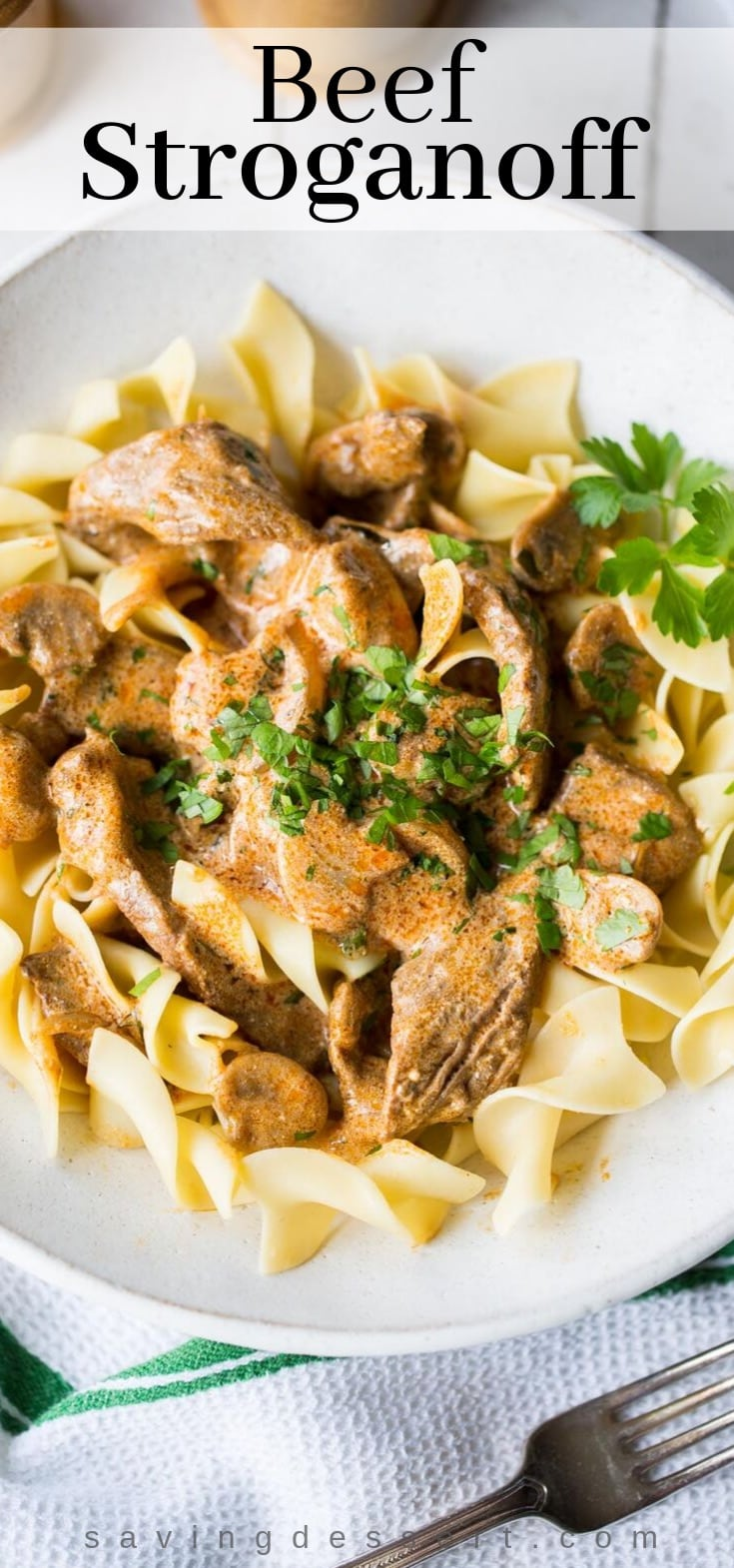 A bowl of beef stroganoff over noodles