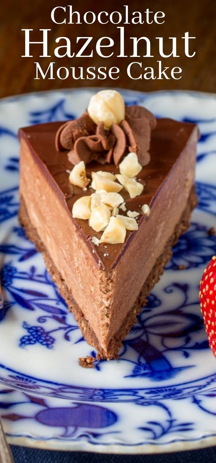 A slice of chocolate hazelnut mousse cake with chopped nuts on top