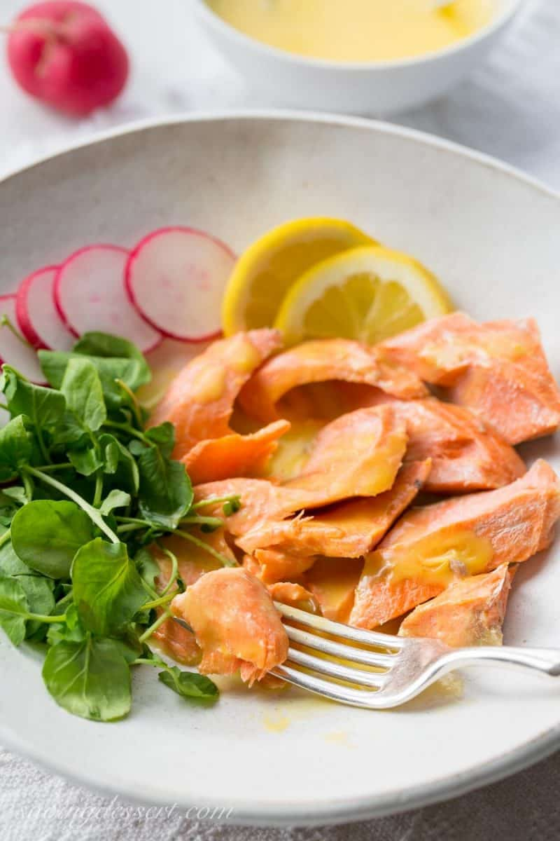 Poached Salmon with Irish Butter Sauce - Wild caught salmon is gently poached in salted water then topped with a lemony butter sauce. The salmon and sauce can be ready in about 20 minutes so that makes this a delicious, quick and easy meal for any night of the week. www.savingdessert.com