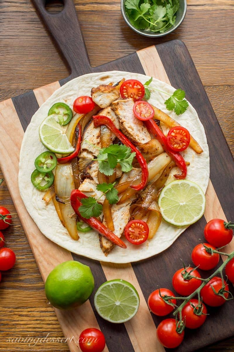 Skillet Chicken Fajitas ~ incredibly easy to make, loaded with bold flavor, sweet sautéed vegetables and tender, juicy chicken. www.savingdessert.com