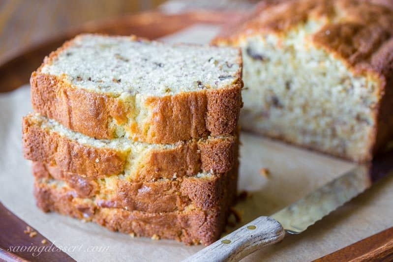 Easy Banana Bread Recipe ~ delicious and easy, and perhaps the best banana bread recipe around! Moist and tender cake loaded with banana flavor and chopped walnuts. Try a slice with cinnamon cream cheese - oh my goodness! www.savingdessert.com