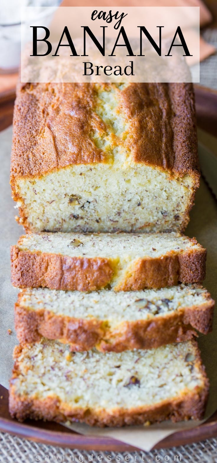 A sliced loaf of banana bread with walnuts