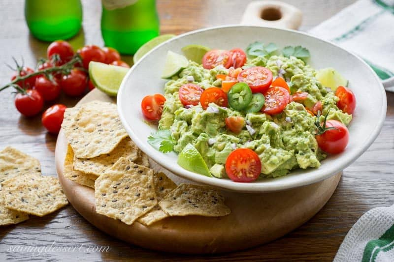 Easy spicy guacamole recipe saving room for dessert easy spicy guacamole incredibly delicious made fresh at your own table hand crafted and forumfinder Images
