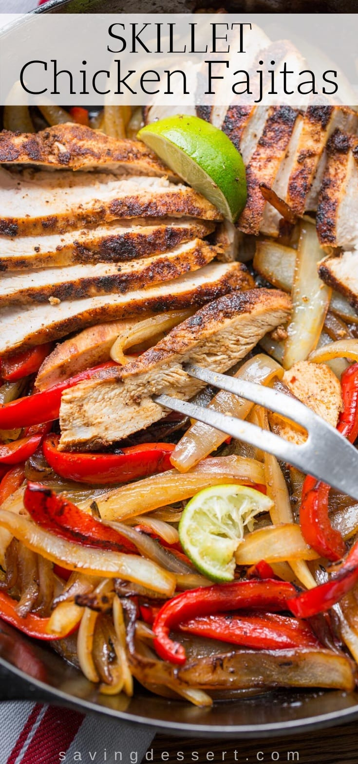 A skillet loaded with sliced chicken fajitas with onions and peppers