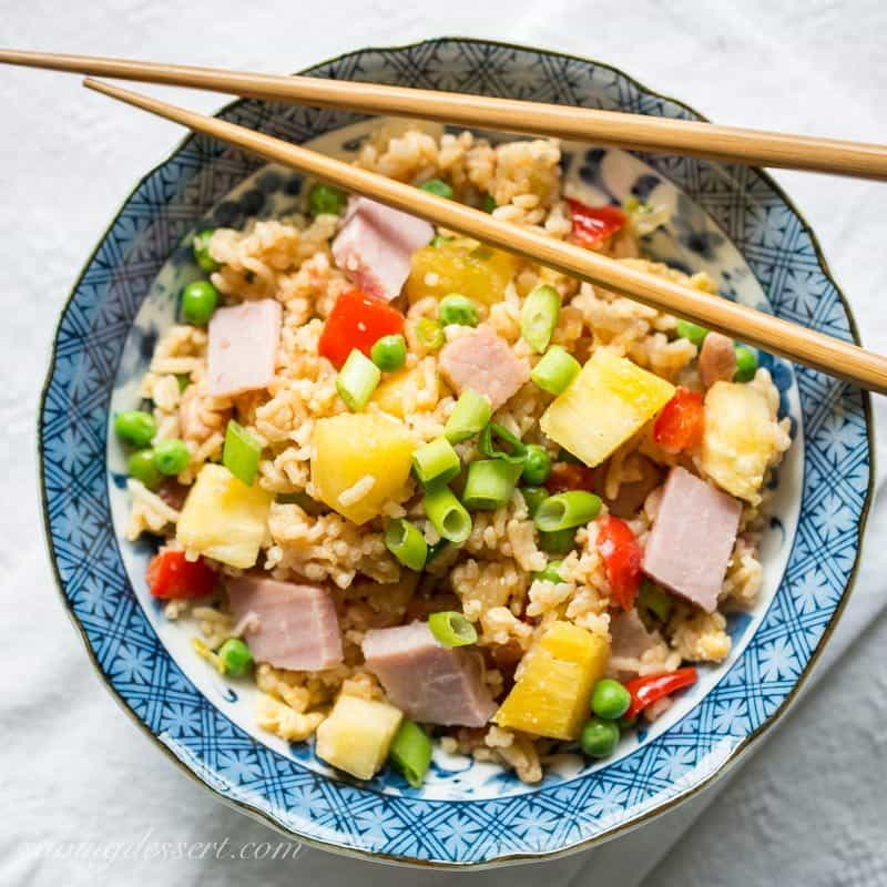 Hawaiian Fried Rice ~ the classic combination of sweet pineapple with salty ham is a winner in this traditional fried rice. Loaded with vegetables, you'll love this easy meal and may just find yourself enjoying leftovers for breakfast! www.savingdessert.com