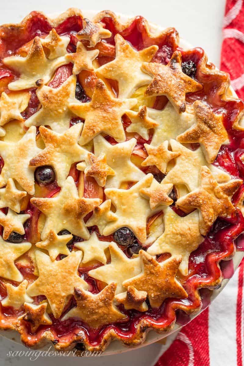 nectarine and blueberry pie with star cutouts for a top crust