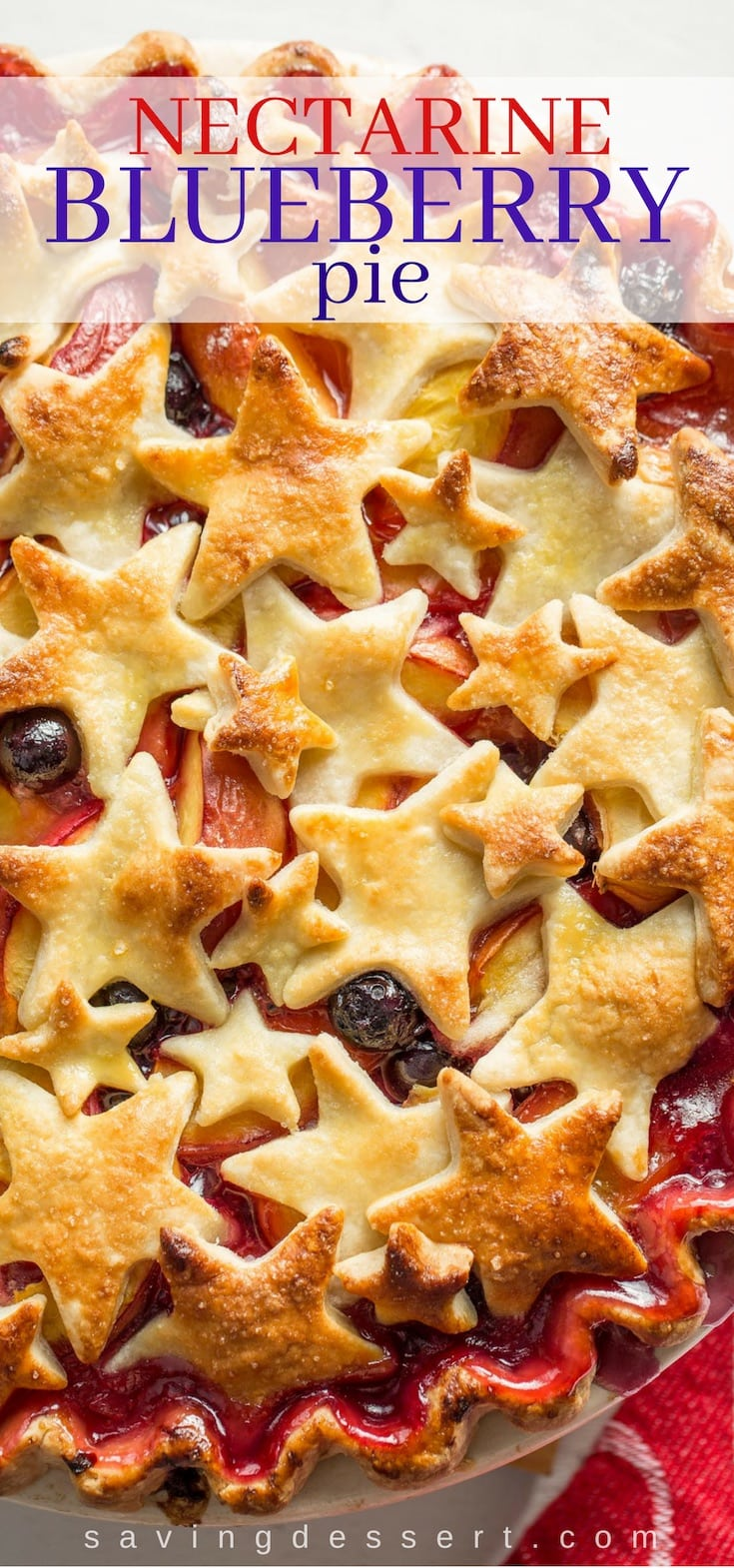 A close up of a nectarine blueberry pie with star cut-outs on top