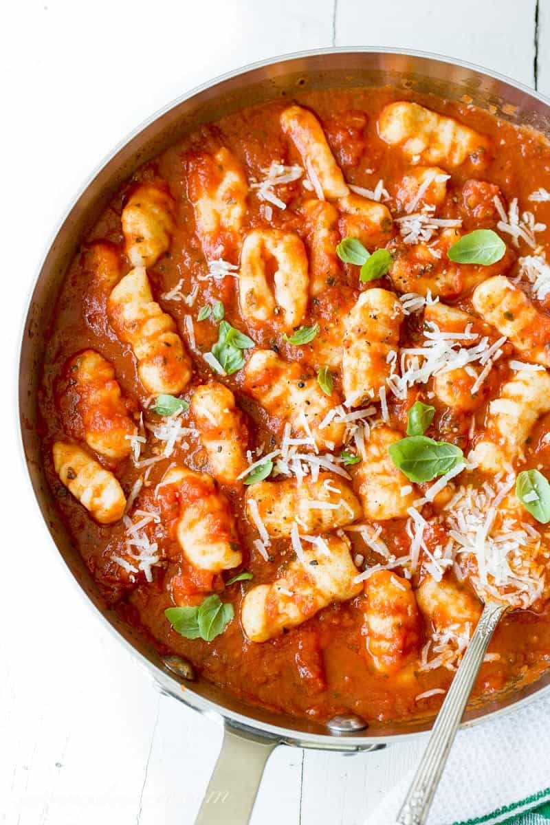 Homemade Potato Gnocchi ~ pillowy soft, delicious potato dough dumplings ~ Cooked like pasta and combined with your favorite sauce, this Italian staple is a must make right in your own kitchen. www.savingdessert.com
