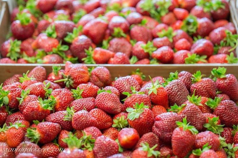 Strawberry Shortcake Scones stacked amongst fresh strawberries Strawberry Shortcake Scones