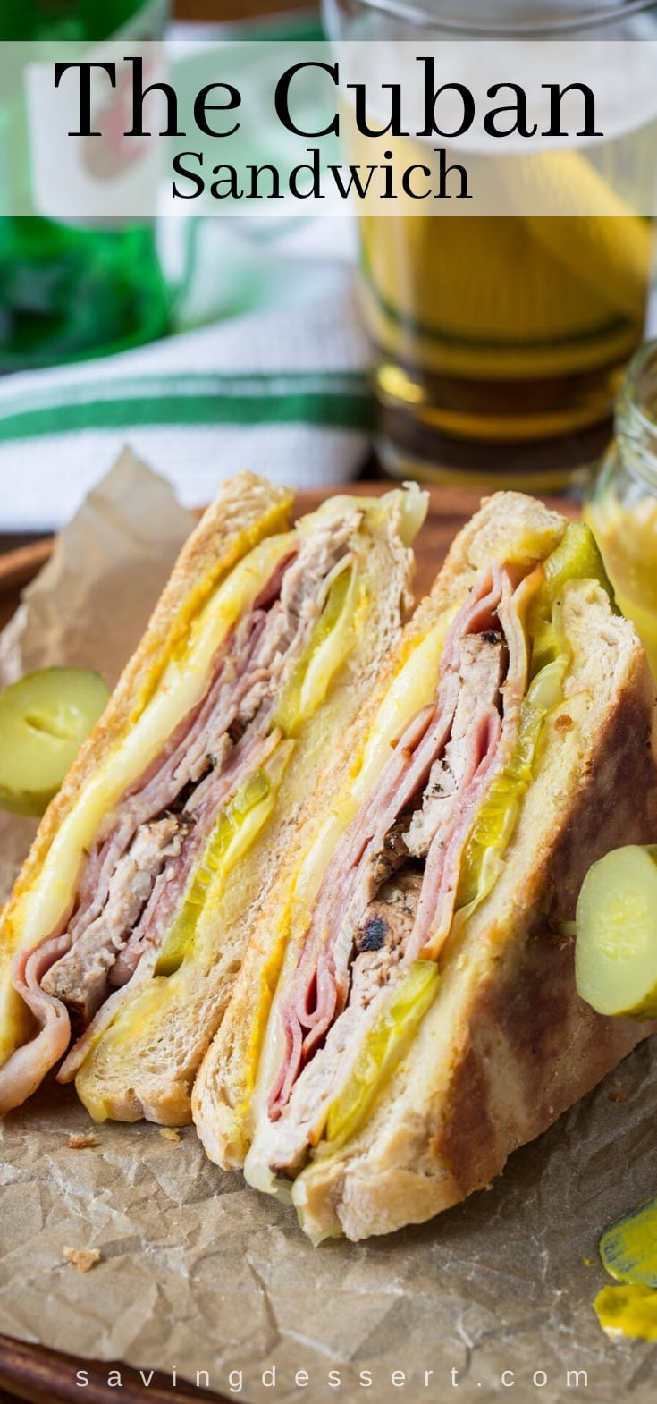 A Cuban sandwich cut in half and served with pickles