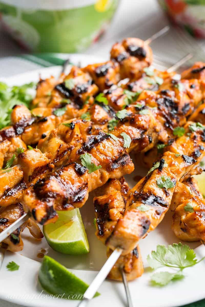Grilled Chicken Skewers with a Sweet Sriracha Glaze and sliced limes