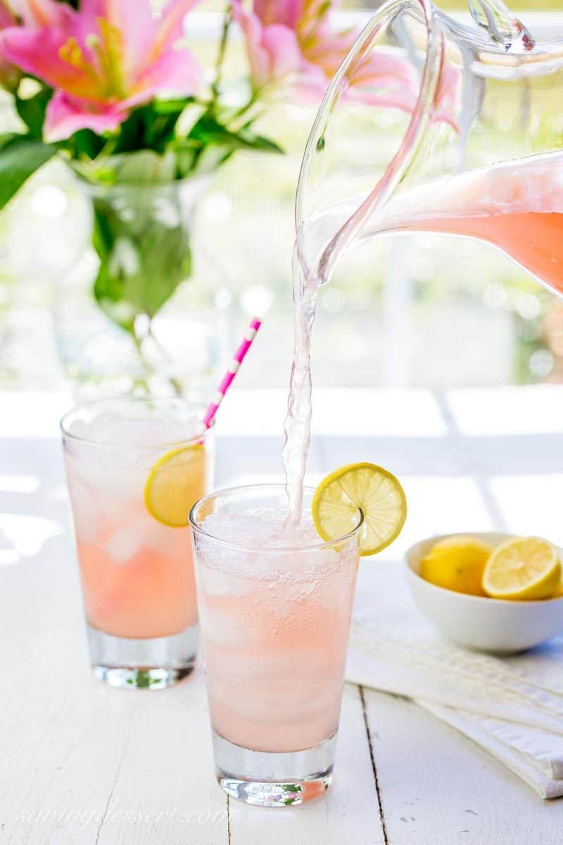 Pink Lemonade ~ bright, tart and lightly sweet, this lovely pink hued summer beverage is very refreshing and super easy to make! www.savingdessert.com